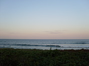 Lennox Head point surfers at sunset